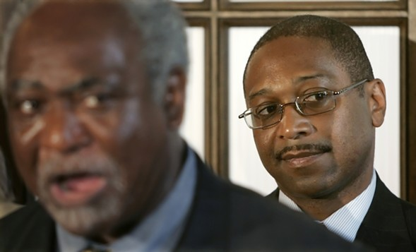Chicago alderman Todd Stroger (right) in 2006, at the press conference after the Cook County Democratic Party picked him to replace his ailing father on the ballot - AP PHOTO/CHARLES REX ARBOGAST