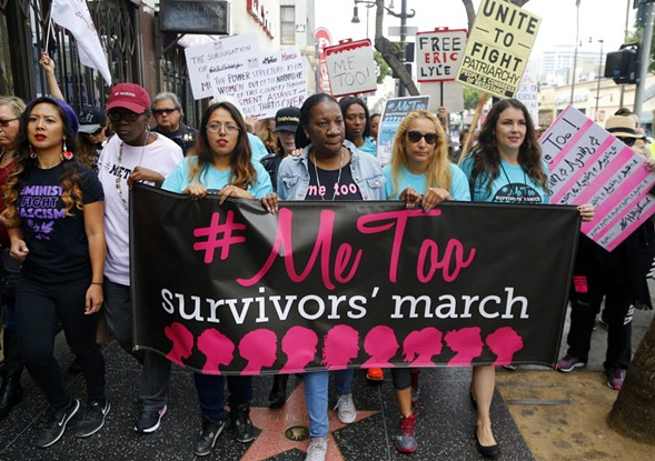 Participants march against sexual assault and harassment at the #MeToo March in Hollywood on November 12. - AP PHOTO/DAMIAN DOVARGANES