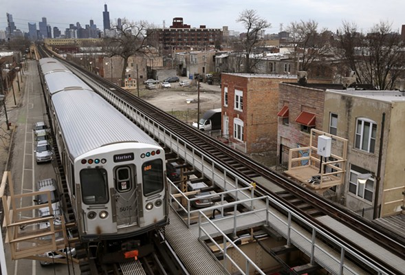 A Green Line train heads west from downtown Chicago. - AP PHOTO/CHARLES REX ARBOGAST