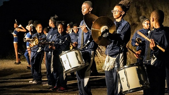 The Horace Mann Marching Mustangs march to the beat of their drums Wed 12/20. - DARIS JASPER