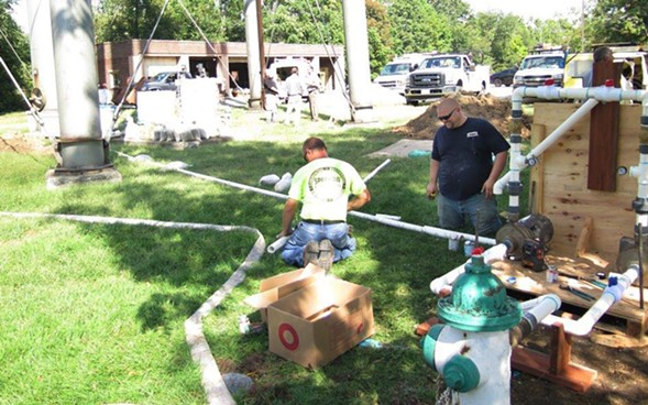 Contractors preparing to flush out a fire hydrant at the state veterans' home in Quincy in September 2015, when there was an outbreak of Legionnaires' disease at the facility. - AP PHOTO/ALAN SCHER ZAGIER