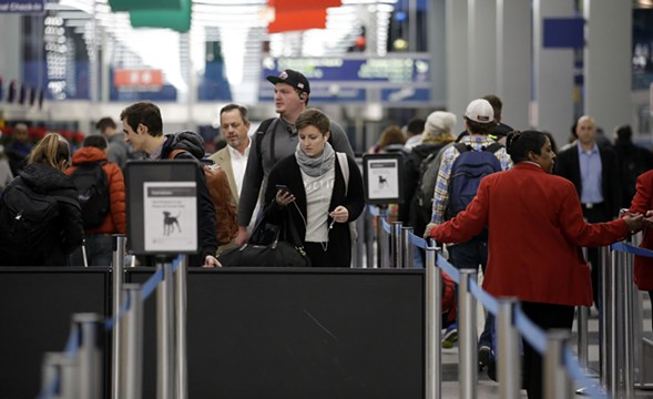 Travelers line up at a security checkpoint area in Terminal 3 at O'Hare Airport before Thanksgiving. - AP PHOTO/NAM Y. HUH