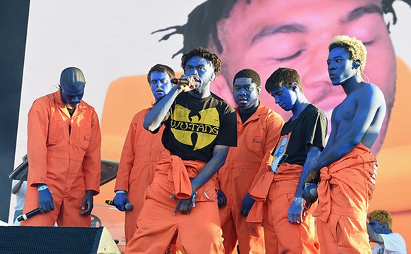 Brockhampton onstage in 2017, with front man Kevin Abstract in the Wu-Tang shirt - KEVIN WINTER/GETTY