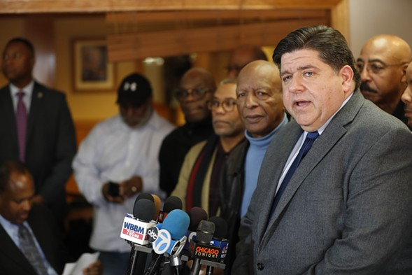 J.B. Pritzker speaks to the media as Illinois secretary of state Jesse White and others look on at MacArthur's Restaurant on Tuesday. - JOSE M. OSORIO/CHICAGO TRIBUNE VIA AP