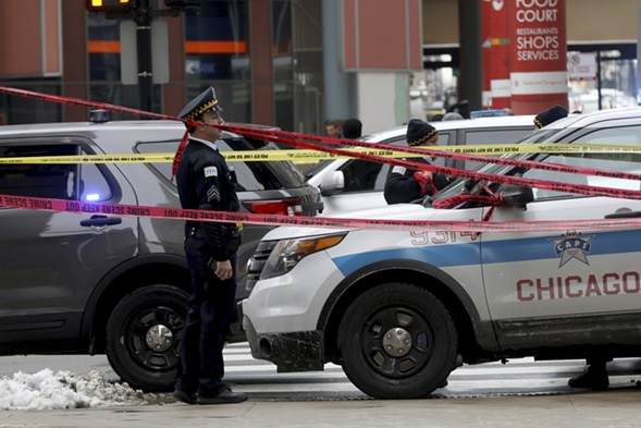 Police guard the scene where Chicago Police Department commander Paul Bauer was fatally shot Tuesday afternoon. - JOHN J. KIM/CHICAGO TRIBUNE VIA AP