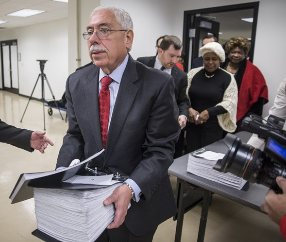 Cook County assessor Joseph Berrios carries nominating petitions for the Democratic slate of candidates. - RICH HEIN/SUN-TIMES
