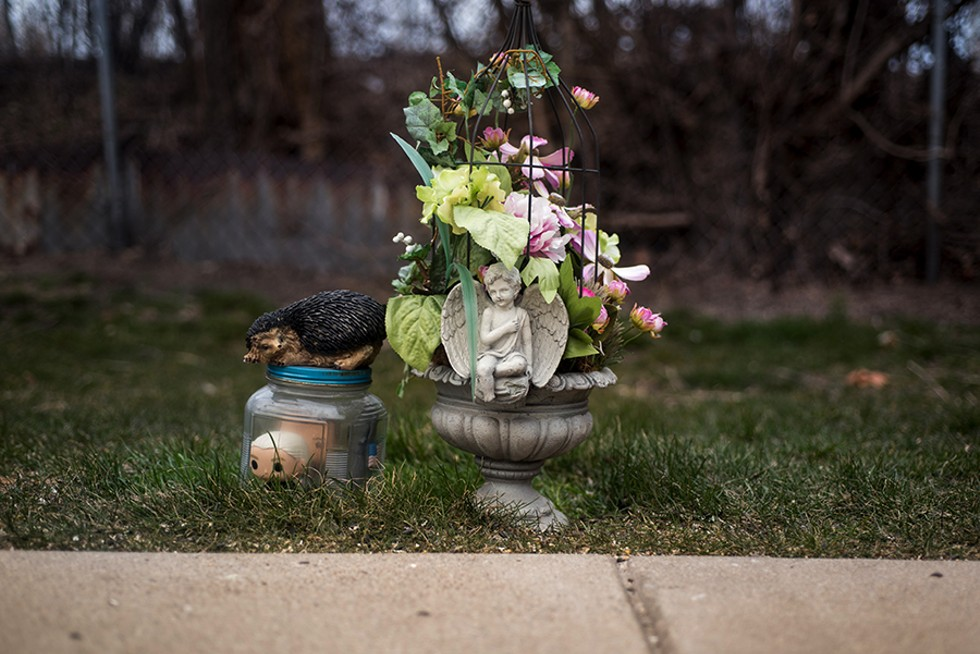 A memorial to Carli marks the spot on the driveway where she died. - MATTHEW GILSON