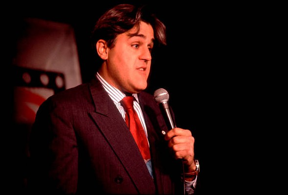 A young Jay Leno, chin and all, performs on Zanies' Chicago stage. - GETTY IMAGES