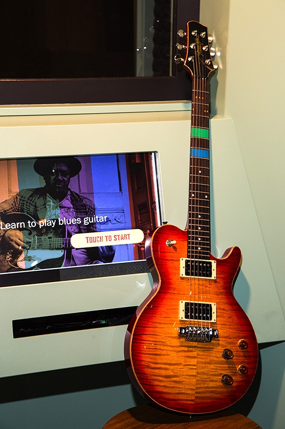 A digital guitar interactive guides visitors through basic blues chords and scales to play rhythm or lead guitar. - CHICAGO HISTORY MUSEUM