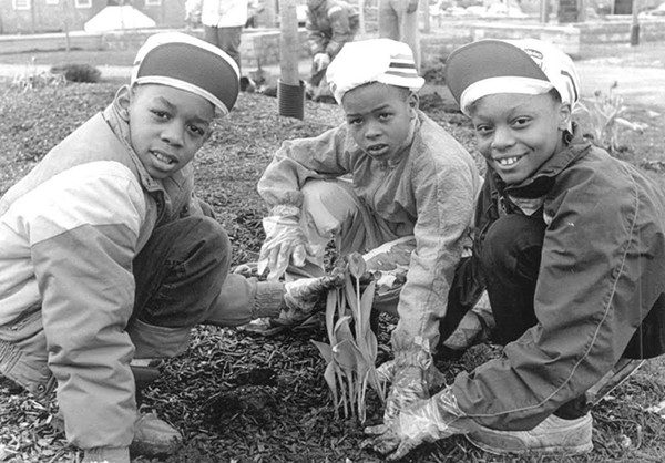 Chicago kids help with a neighborhood cleanup and planting on Earth Day in 2011. - SUN TIMES ARCHIVE