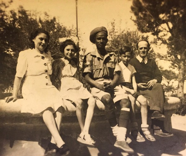 Rachel, Eugenia, Beno, and Isaac Weiss with an Indian soldier from the British army in Atessa, Italy, just after the Allied liberation of Italy. - WEISS FAMILY
