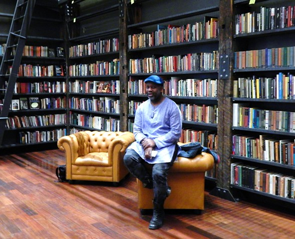 Theaster Gates in the library at the Stony Island Arts Bank - DEANNA ISAACS