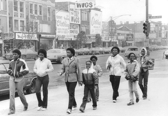A family in West Garfield Park in 1983 - BOB BLACK