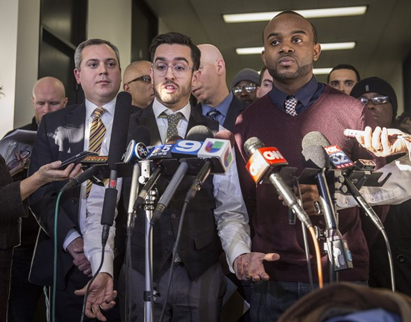 From left, attorney Matt Topic, journalist Brandon Smith, and activist William Calloway in November 2015, after a Cook County judge ruled that the CPD should release the Laquan McDonald video. - RICH HEIN/SUN-TIMES
