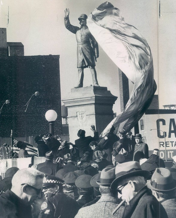 The police officer statue in Haymarket Square at its rededication in 1971 after it was bombed for a second time. Mayor Richard J. Daley stands in front, saluting. - DUANE HALL/CHICAGO SUN-TIMES