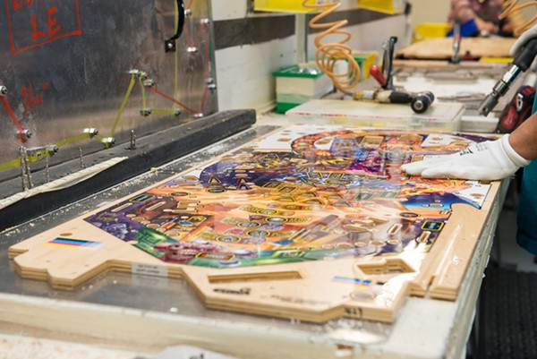 Pinball play fields being built on the assembly line - JAMIE RAMSAY