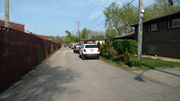 A section of S.H. Bell's property line (left) runs parallel to houses on E. 103rd. - MAYA DUKMASOVA