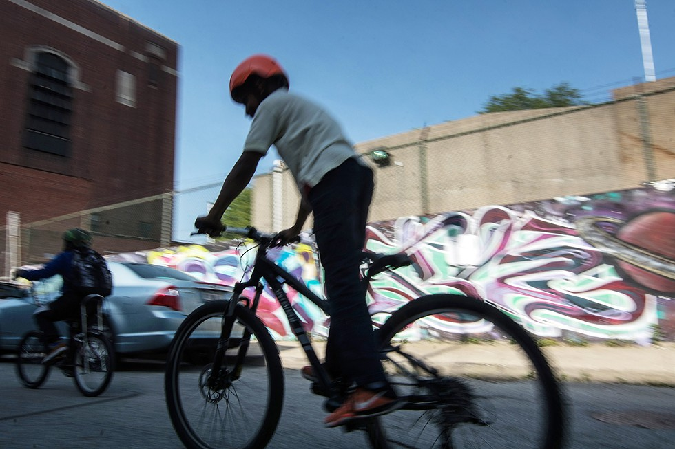 On Fridays, Blackstone Bicycle Works' participants gather for weekly bike rides through Woodlawn. Each youth is selected by the amount of hours they put into the shop per week, and promising candidates are asked to help lead and rate the route. - SEBASTIÁN HIDALGO