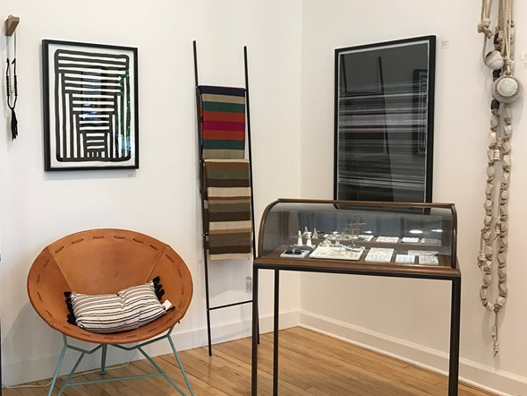 Artwork by Michael McGuire, striped blankets by Garza Marfa, and wall hangings by MQuan Studio - ISA GIALLORENZO