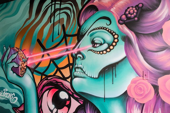 Yolocone's original piece painted on the wall of El Santo Taqueria. - JAMIE RAMSAY