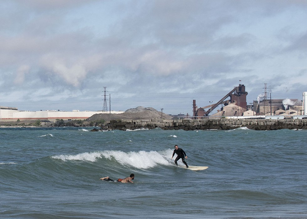 Surfers catch waves last month off the shore of Whiting, Indiana - RICHARD ANDERSON