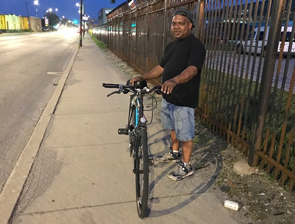 Darryl Heard stands with his bike in Chicago Police Beat 1011, which had the highest ticketing numbers in 2016 and 2017. - JOHN GREENFIELD