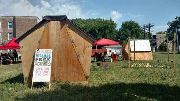 """Organizers vowed to resist an impending eviction of the """"Healing Village."""" - MAYA DUKMASOVA"""