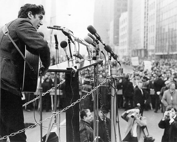 Phil Ochs during a 1967 Vietnam protest outside the UN building in New York. - MICHAEL OCHS