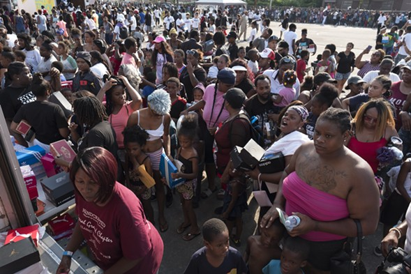 "An estimated 20,000 to 30,000 people attended the ""anti-bait truck"" giveaway. - RICK MAJEWSKI/SUN-TIMES"