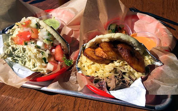 Reina Pepiada arepa; arepa with pulled pork, Gouda, and plantain, Sweet Pepper Venezuelan Food Bar - MIKE SULA