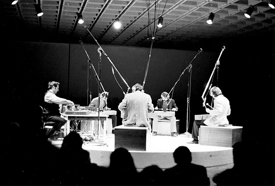 Steve Reich (left) guides Philip Glass, Jon Gibson, Richard Landry, and Arthur Murphy in a performance of his new work Four Log Drums at the Whitney Museum of American Art in 1969. - RICHARD LANDRY
