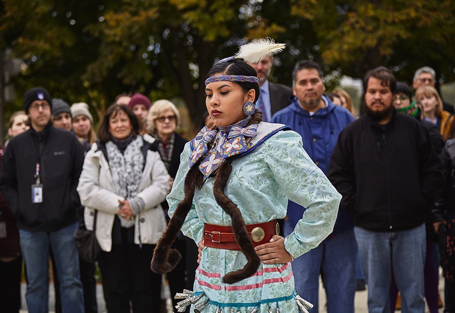 Maritza Garcia of the Mississippi Choctaw performing a jingle dress dance at a ceremony on October 26. The ceremony was held to recognize that the Field Museum rests on the homeland of three tribes. - MICHELLE KUO