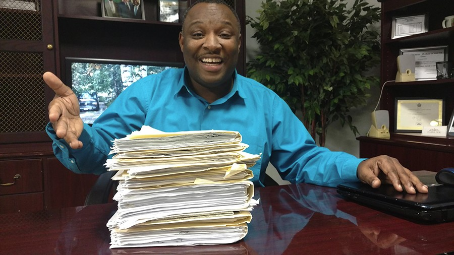 Twentieth Ward aldermanic candidate Andre Smith, who's run for the seat unsuccessfully two previous times against Cochran. Here he's showing a stack of affidavits obtained from each person he asked to sign his nominating petitions. - MAYA DUKMASOVA