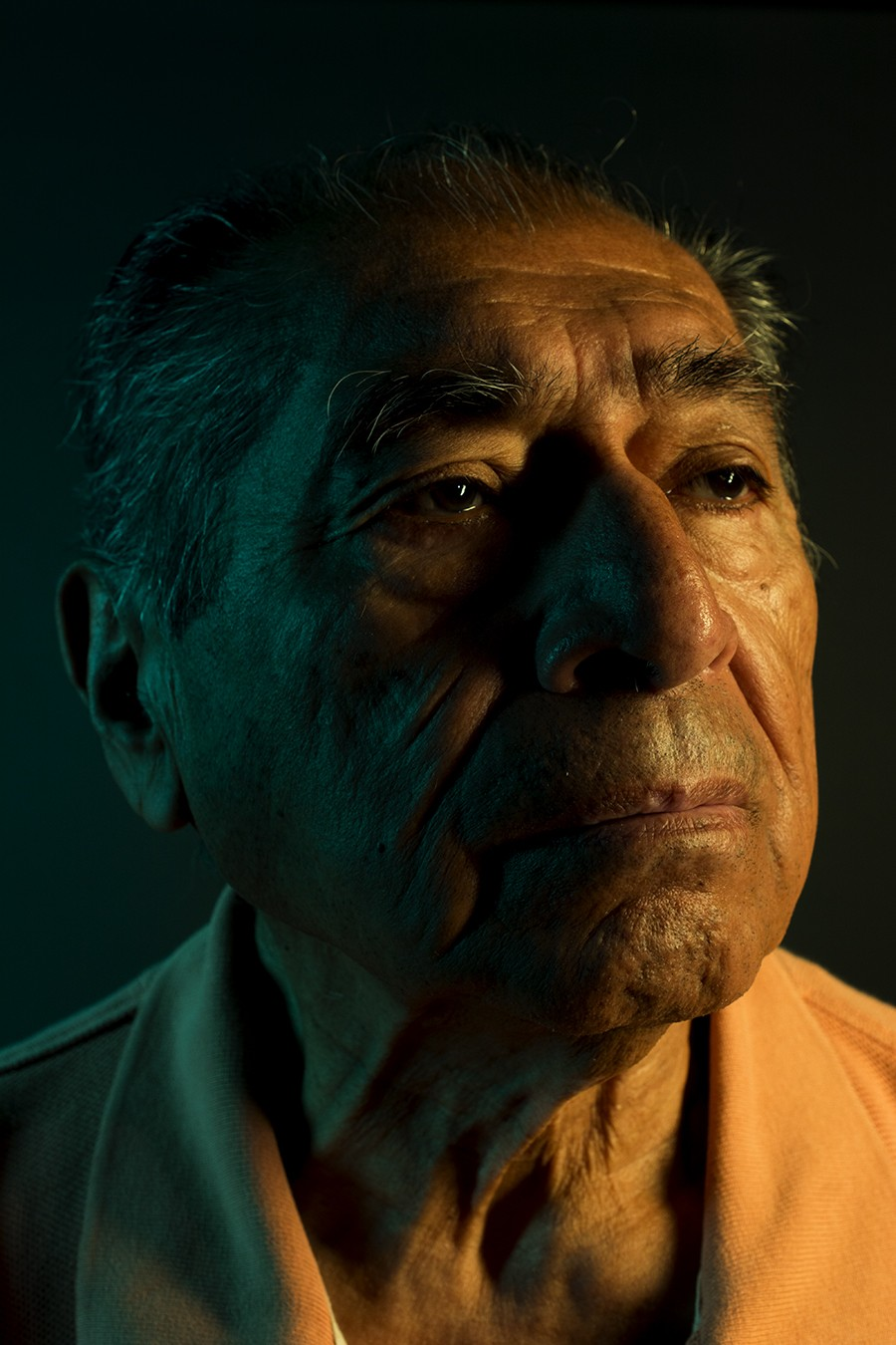 This is one of Guzman's favorite pictures of his grandfather. As the subject of a school technical assignment, all Garcia had to do was show up while Guzman created a portrait using colored gels. - GONZALO GUZMAN
