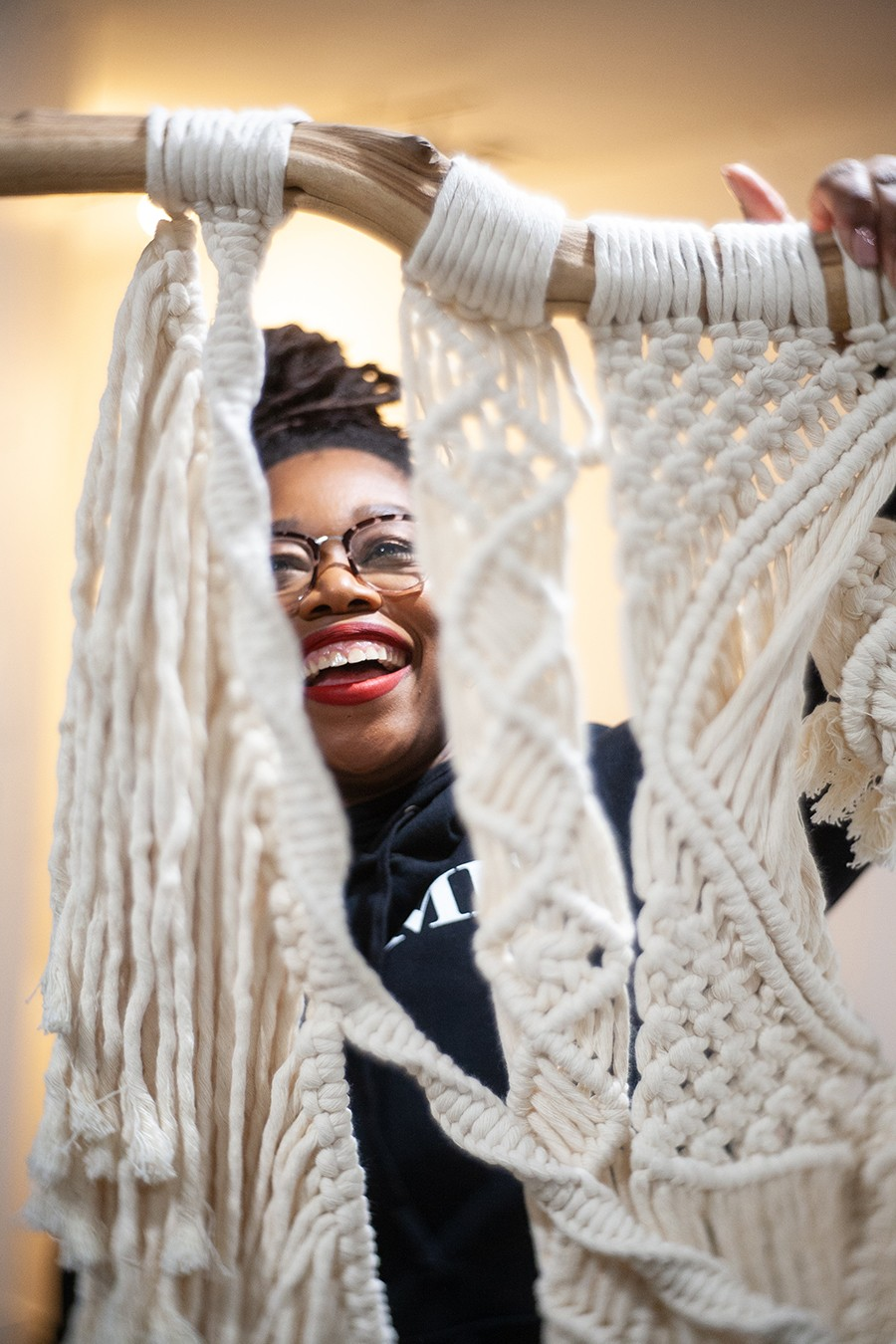 Kenyatta Forbes and one of her macrame pieces - DAVON CLARK
