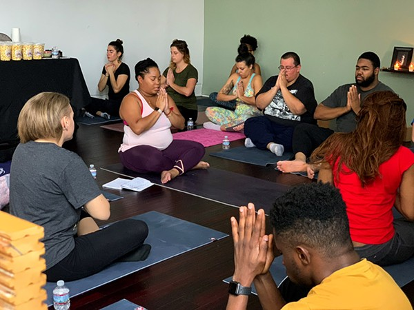 Angelica K. Lewis, owner of Curvy Chick Yoga, leads class. - JINDU ELUEZE
