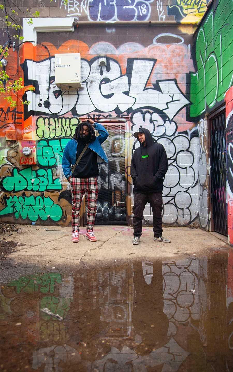Qari (in plaid pants) and Green Sllime outside Sllime's apartment in Logan Square - DAVON CLARK