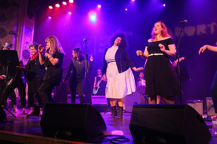 "The singers of De Re #MeToo all take the Metro's stage at once to close Thursday's concert with Nancy Sinatra's ""These Boots Are Made for Walkin'."" - AMY SMEKAR"