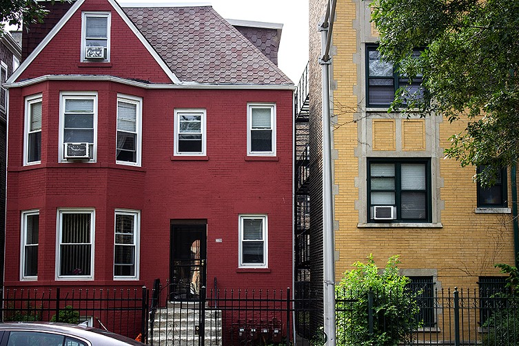 """""""Don't let me get started about Pangea!"""" said Ronald Hunt Sr., the owner of a red house next door to one of the company's apartment buildings in South Shore. - MATTHEW HARVEY"""