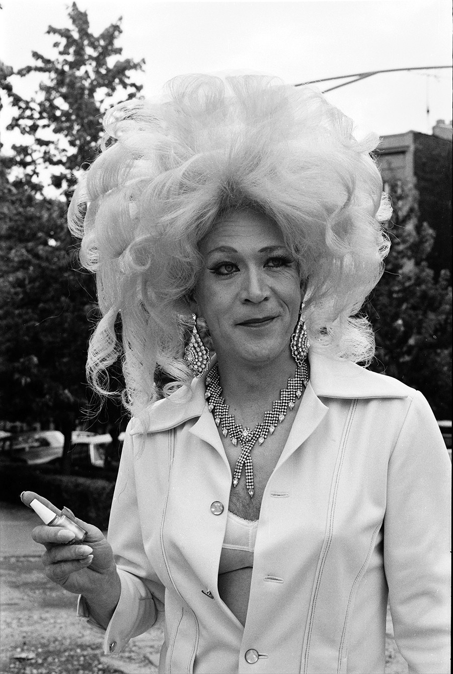 A drag queen waits for the parade to begin on the side streets of Belmont and Broadway - DIANE ALEXANDER WHITE
