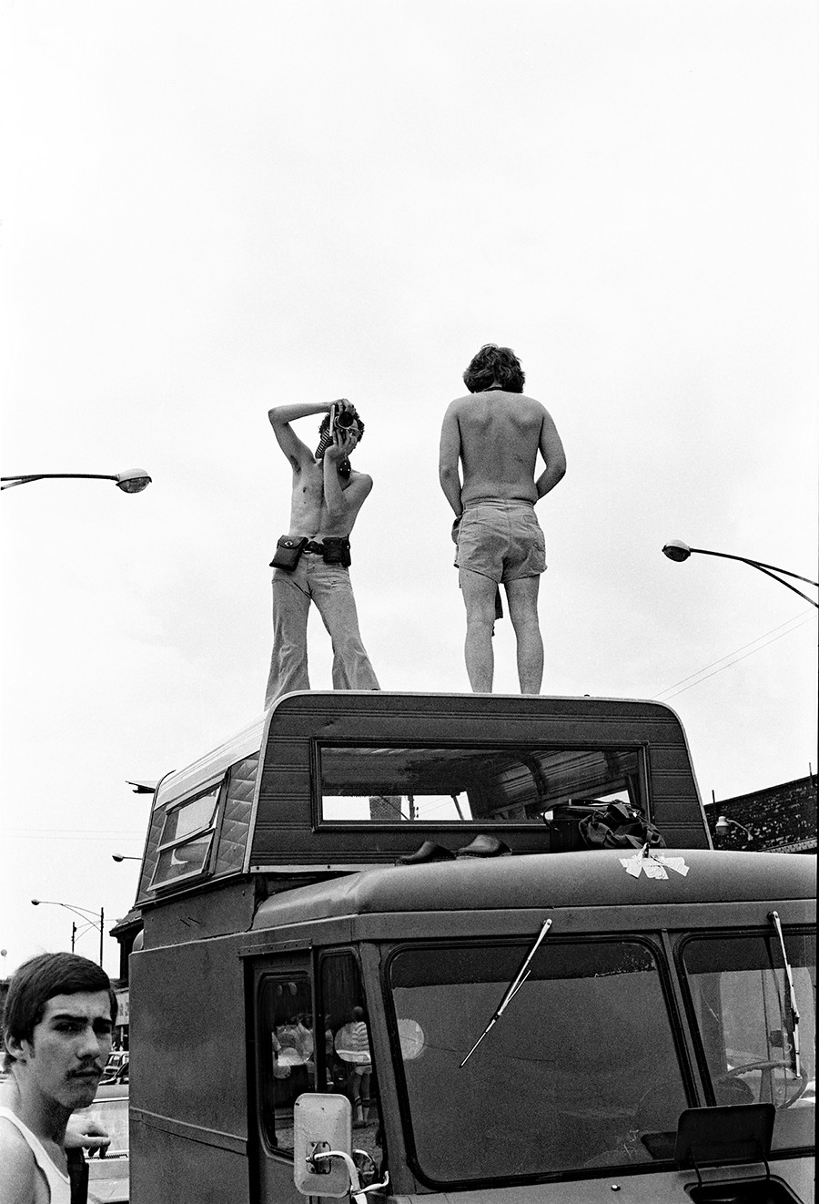 Documenting the Gay Pride Parade atop a makeshift shooting platform. - DIANE ALEXANDER WHITE