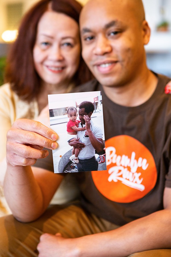 Chef Chris Reed with his mother, Priscilla. Chris holds a photo of his late father, Donald, carrying him as a child. - ALEXUS MCLANE