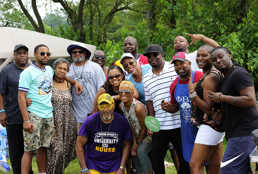 D'Angelo DaReef (blue apron) and his wife, Vanessa (white shorts), with their friends and family - ZAKKIYYAH NAJEEBAH