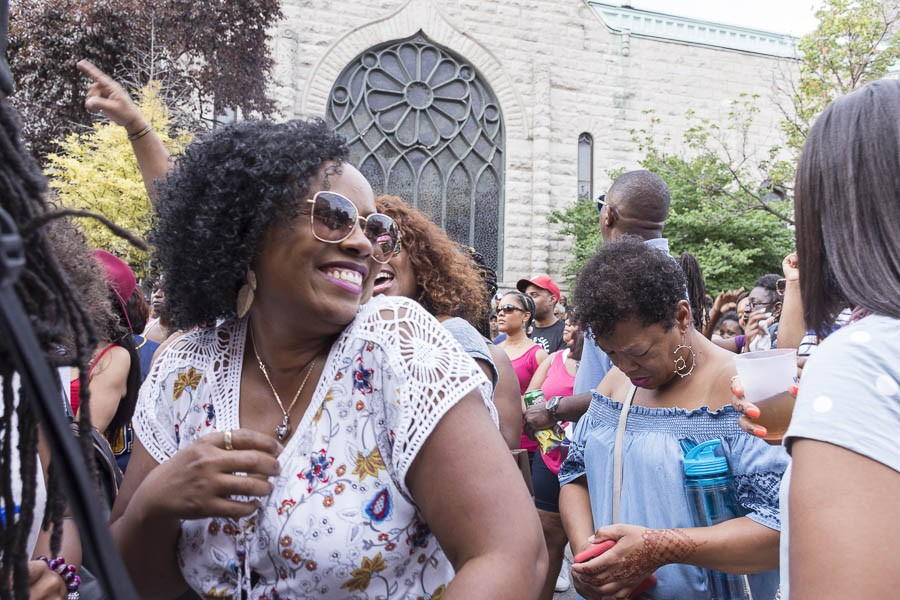 Giovanni Broughton and other partygoers dance to Ron Trent's DJ set at the 2017 Silver Room Block Party. - APRIL ALONSO