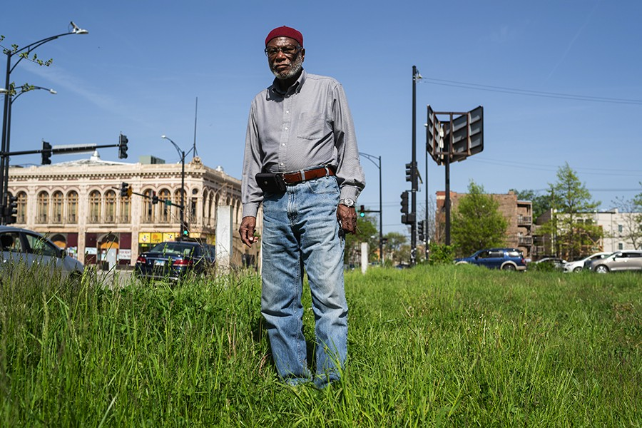 Longtime Woodlawn resident and jazz enthusiast Abdul Karim stands on the grounds where the Pershing Hotel and Budland night club used to be on Cottage Grove Avenue and 64th Street. Karim recalls the days in the 1960s when he would soak in the sounds of local and out of town jazz players in numerous clubs along Cottage Grove. - MAX HERMAN