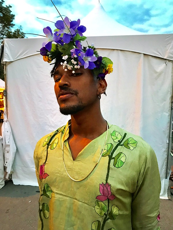 Choya Webb repurposed the flowers in his headdress from an event he threw. - ISA GIALLORENZO