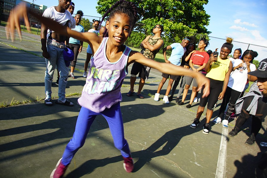 Young camper Sarah Slaughter takes her turn in the circle at Open the Circle's footwork summer camp in Robert Taylor Park on Wednesday, July 24. - WILLS GLASSPIEGEL
