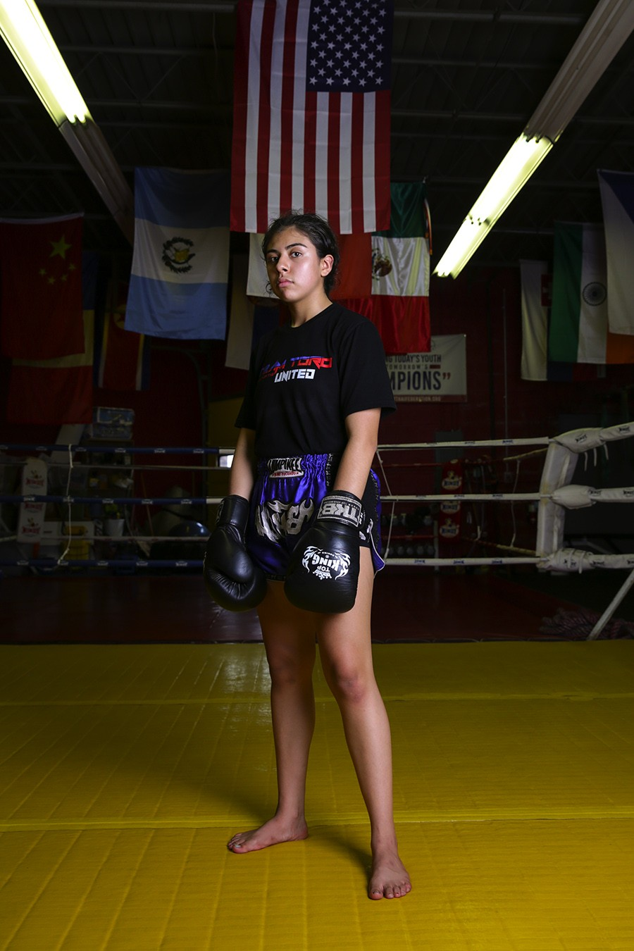 """Arianna Shastri, 16, of Team Toro Janjira  [On fighting in Thailand] """"It was definitely different because we, me and my teammate, were the only American[s], and even on the fight card they didn't have the American flag just because they didn't know where we we're from. It was very nerve-wracking because I was the first fight of the entire card. It clicked for me when I went inside [the ring], like, 'Oh, I'm actually doing this.' This was my first fight without shin guards, as well. I've never fought without shin guards and so it was a new experience, but it was really fun. A lot of things were happening at once. It was like, 'OK, this is happening. I need to like get my shit together like right now.'"""" [On winning] """"When they raised my hand I was like, I just won in Thailand against a Thai girl. I was very happy; it was a very happy experience. I didn't go with my mom or parents. It was just me, my coach, and my teammate. Now, I'm getting ready to go to Turkey with the national team."""" - GEOFF STELLFOX"""