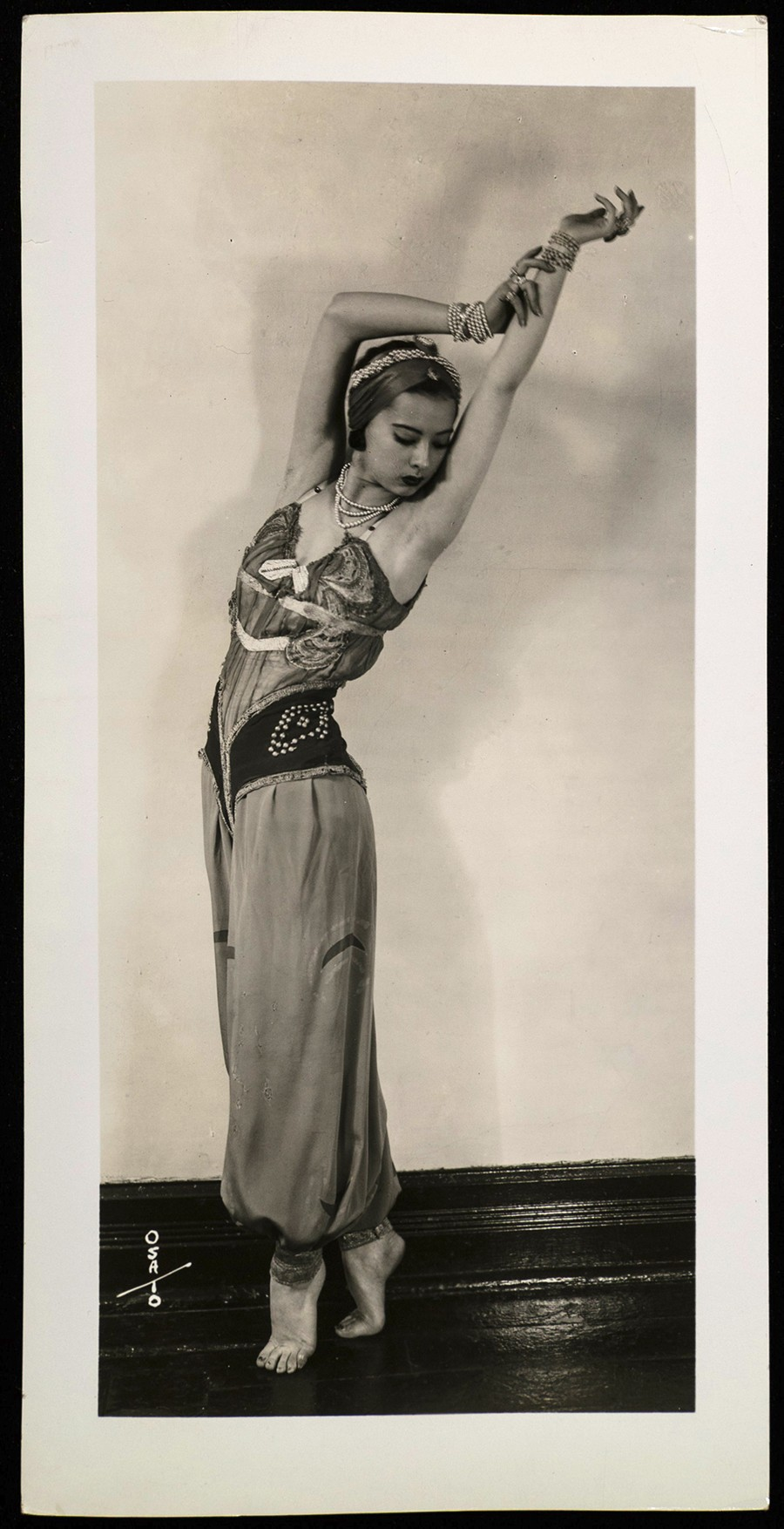 Sono Osato recreates her solo part as Scheherazade's chief concubine in in her father's Chicago photo studio. - COURTESY NEWBERRY LIBRARY