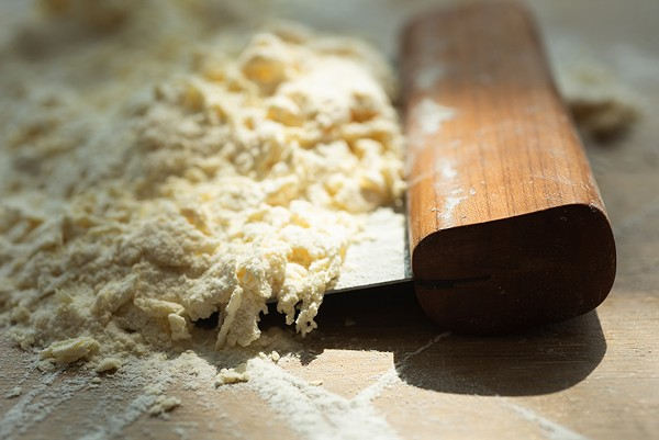 Once a shaggy dough has formed it's gathered together using a pasta scraper, then kneaded. - MATTHEW GILSON